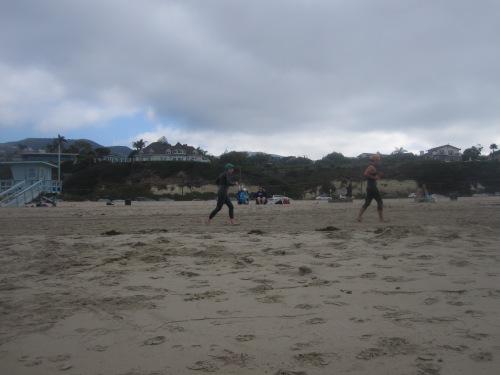 running during open water swimming drills