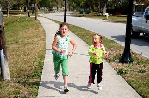 Remember the pure joy of running! These girls are loving the Delphi Walk-a-thon. Photo by familylife.