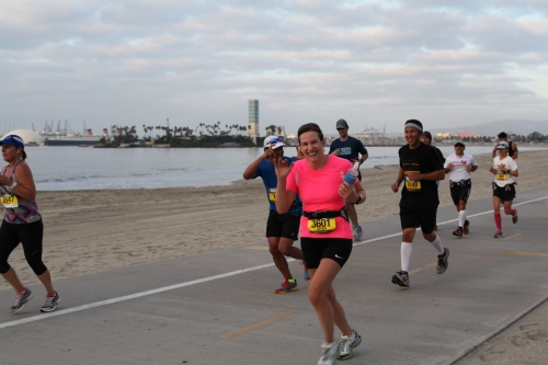 All smiles on the beach path at mile 7. I wore neon pink so my family could see me a mile away (their words)!
