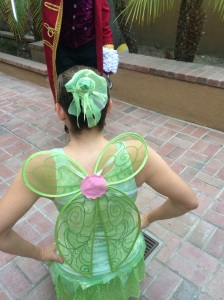 Upside down Tinker Bell wings and the hairpiece my 9-year-old ballerina crafted for me out of the fabric scraps from the tank top.