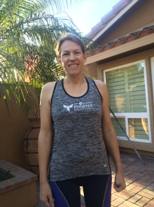 Me ready for spin class this morning in the cute race tank top (the men got short-sleeved shirts in the same color), minus the blue arm sleeves we also received.