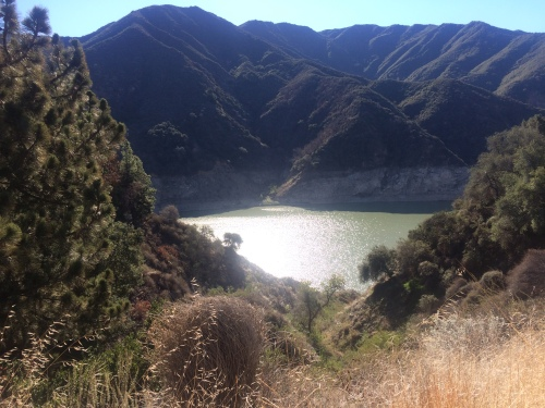 The welcome sight of water in the San Gabriel Reservoir, although you can see how the waterline has dropped significantly due to the drought.