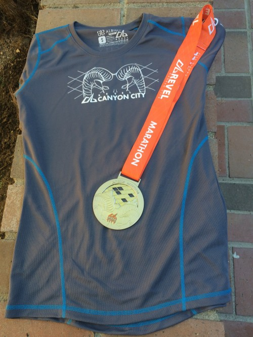 Flattering gray and blue shirt shown with my marathon finisher's medal